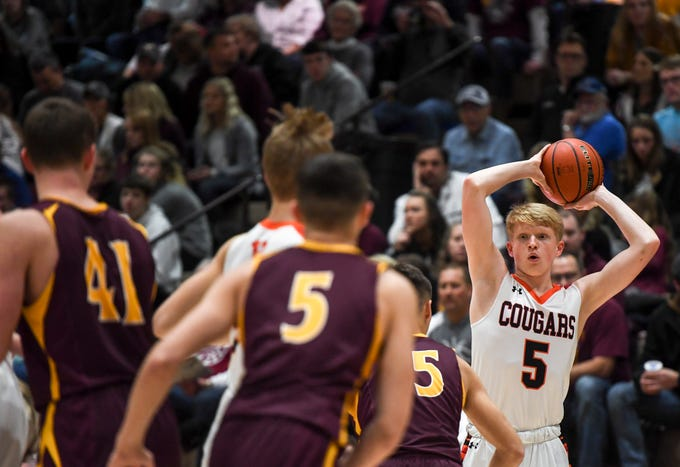 Viborg-Hurley's Eli Boomgarden (5) looks to make a pass during the game against De Smet on Saturday, Jan. 25, 2020 at the Corn Palace in Mitchell, S.D.