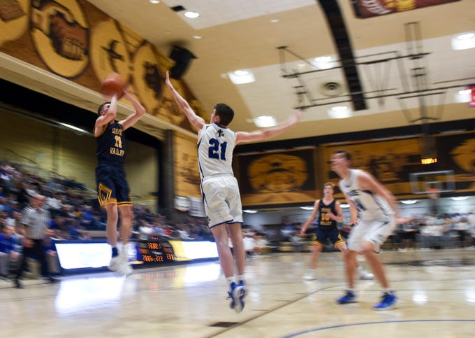 Sioux Valley's Kelton Vincent (11) goes up for a shot while St. Thomas More's Caden Casey (21) guards during the game on Saturday, Jan. 25, 2020 at the Corn Palace in Mitchell, S.D.