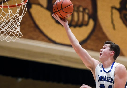 St. Thomas More's Ryder Kirsch (24) goes up for a shot during the game against Sioux Valley on Saturday, Jan. 25, 2020 at the Corn Palace in Mitchell, S.D.