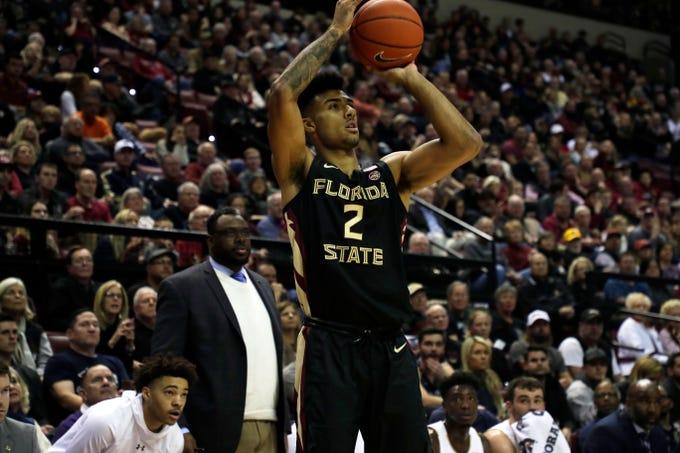 Florida State Seminoles guard Anthony Polite (2) shoots for three. The Florida State Seminoles beat the Notre Dame Fighting Irish 85-84 on Saturday, Jan. 25, 2020.