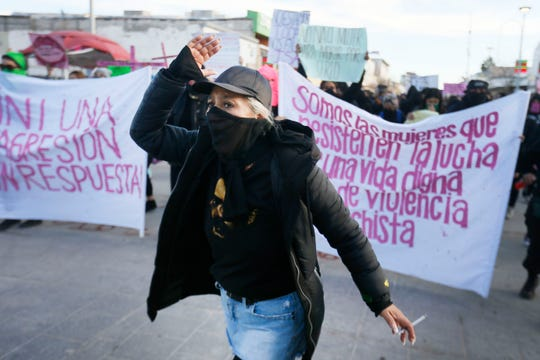 People gather in front of the Museum of the Revolution in Juarez for a protest march demanding justice for the murdered Juarez artist and activist Isabel Cabanillas Saturday, Jan. 25, near the Paso Del Norte Bridge.