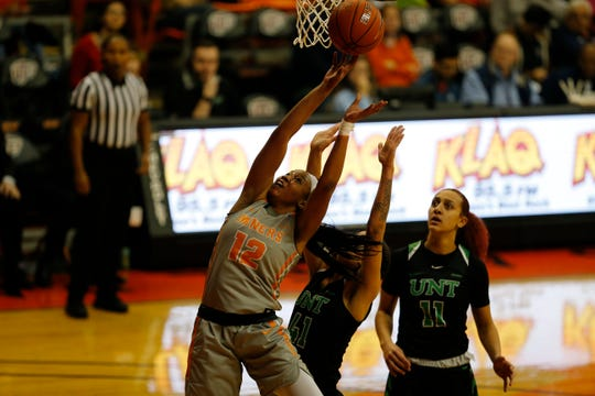 UTEP's Ariona Gill goes up for one of her 11 rebounds Saturday against North Texas