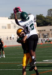 Kyrie Wilson, shown catching a touchdown pass during the Ventura County All-Star Football Game, was a big reason Pacifica won its first state title last fall.