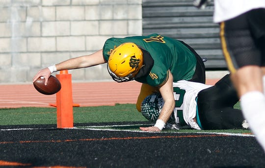 Moorpark High quarterback Blake Sturgill scores a touchdown in the second half for the East team during the 47th annual Ventura County All-Star Football Game on Saturday at Ventura College.