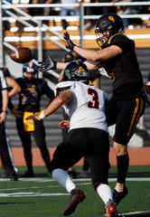 Newbury Park High's Braden Hutten of the East team looks to catch a pass during the 47th annual Ventura County All-Star Football Game on Saturday at Ventura College.