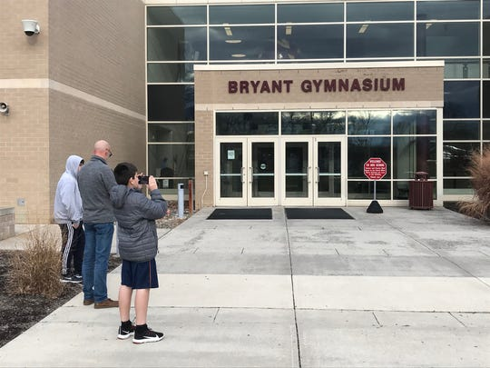 After word began to spread Sunday afternoon of basketball start Kobe Bryant's death, some fans traveled to Lower Merion High School inn Ardmore, Pennsylvania, where he played.