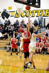 Faith Stinson goes up for a layup during the third quarter of Sheridan's 46-38 win against host Tri-Valley earlier this season. The Scotties were voted the top seed in Division II in the East District, and the Generals were given the second seed in Division II in the Southeast District.