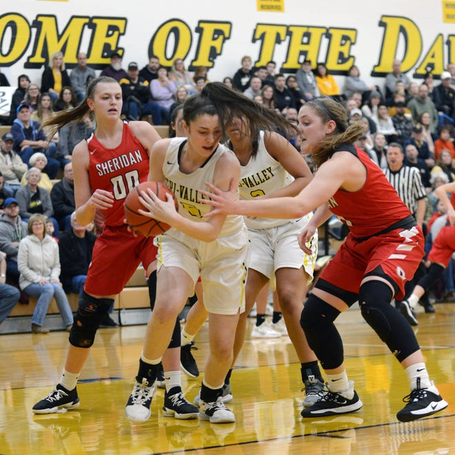 Tri-Valley's Janie McLoughlin pulls down a rebound against Sheridan on Saturday night in Dresden. Sheridan won the game, 46-38, to pull into a tie for the Muskingum Valley League lead.