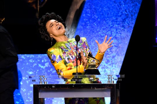 """Esperanza Spalding accepts Michelle Obama's Grammy win for """"Becoming"""" and also snagged one of her own: best jazz vocal album for """"12 Little Spells."""""""