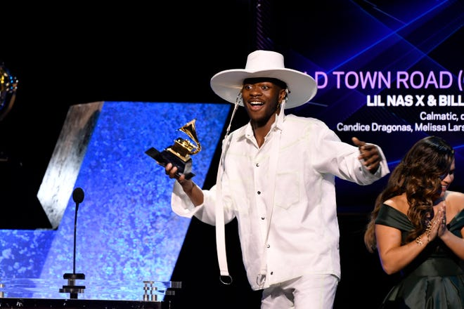 Lil Nas X accepts the award for Best Music Video for 'Old Town Road' during the Grammy Awards preshow. He later won best pop/duo group performance at the early ceremony.