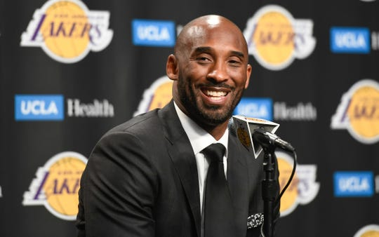 Former Laker great Kobe Bryant answers questions from the media before the Lakers game against the Golden State Warriors at Staples Center on Dec 18, 2017. Bryant's numbers 8 and 24 were to be retired during a halftime ceremony.