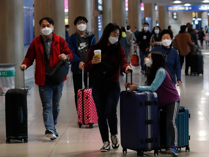 Passengers wear protective masks at Incheon International Airport in Incheon, South Korea.