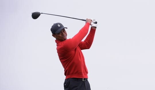 Tiger Woods plays his shot from the fourth tee during the final round of the Farmers Insurance Open.