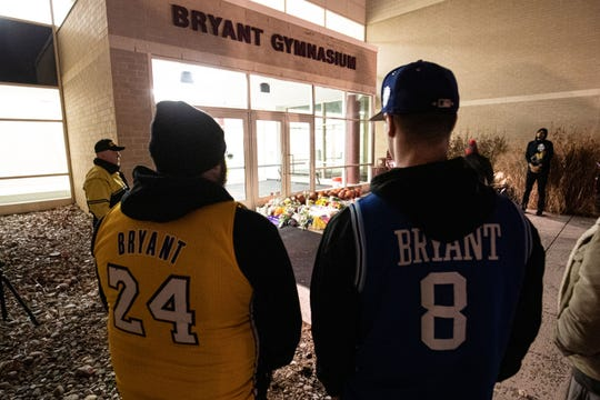 Jan 26, 2020; Ardmore, Pennsylvania, USA; Fans gather to pay their respects to NBA Kobe Bryant outside Lower Merion High School. Mandatory Credit: Bill Streicher-USA TODAY Sports