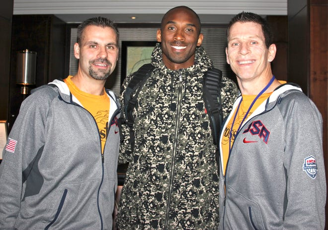 Crossfire Ministry's Randy Shepherd, left, and Jamie Johnson pose with Kobe Bryant at a hotel in London in 2012.