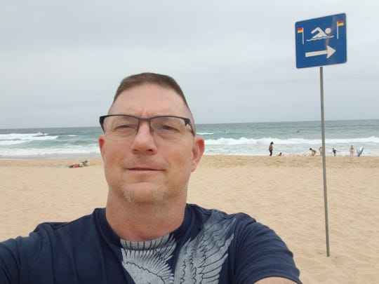 Michael Williams, a senior firefighter on the Nantahala National Forest, is serving a month-long deployment on the bushfires in Australia. Here he takes in the sights of Manley Beach on his day off.