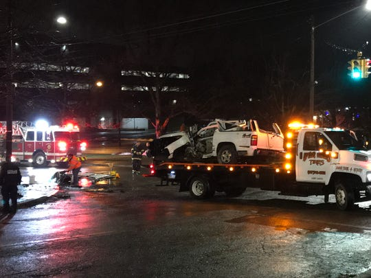 A vehicle is towed from the scene of a crash at the intersection of Oak Hill Avenue and Watson Boulevard on Jan. 25, 2020.