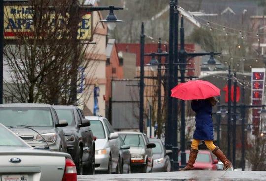 A pedestrian crosses Fourth Street in downtown Bremerton on Jan. 21.