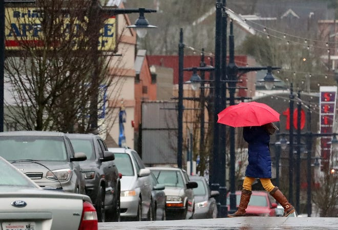A pedestrian crosses Fourth Street in downtown Bremerton on Jan. 21.