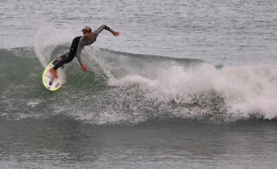Logan Radd, 13, of Satellite Beach was back in the water in his hometown Monday afternoon, a day after winning the Toyota USA Prime Surfing boys U14 event at Sebastian Inlet.