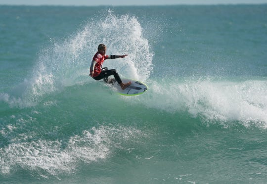 Satellite Beach's Logan Radd shows his form en route to an 8.67 scoring ride in the Toyota USA Prime Surfing event at Sebastian Inlet on Sunday, which sent him to the boys U-14 title.