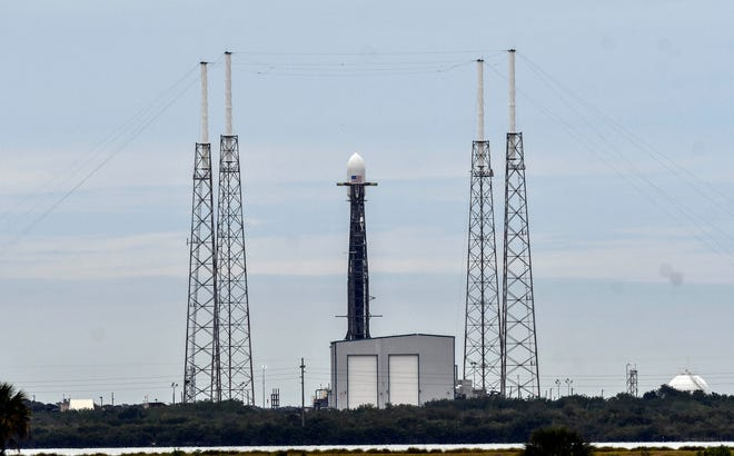 SpaceX's Falcon 9 rocket sits on the pad at Cape Canaveral Air Force Station's Launch Complex 40 on Monday, Jan. 27, 2019. The launch attempt was scrubbed due to powerful upper-level winds.