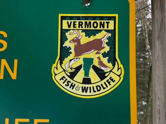 The logo for the Vermont Department of Fish and Wildlife is featured on a wildlife management area sign in Richmond.