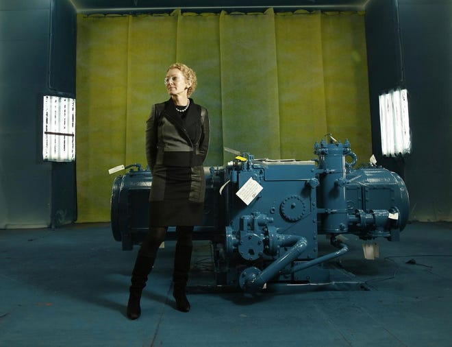 Ariel Corp. leader Karen Buchwald Wright poses in front of one of her company's compressors in a 2013 portrait at its headquarters in Mount Vernon, Ohio.