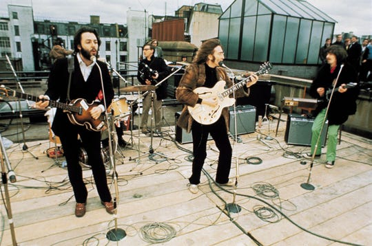 The Beatles perform on the rooftop at Apple on Jan. 30, 1969.