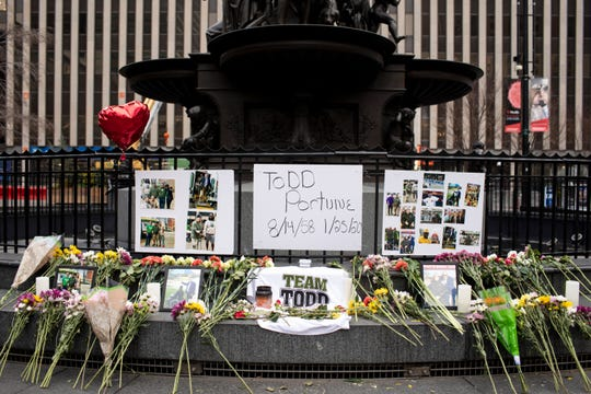 """Flowers and photos were placed as a memorial on Fountain Square for Hamilton County commissioner Todd Portune on Monday, January 27, 2020 in downtown Cincinnati. Portune, 61, """"passed with grace and peace"""" Saturday at his Green Township home surrounded by his family, according to a news release."""