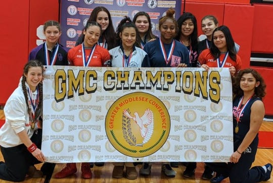 Eleven champions were crowned in Sunday's inaugural GMC Girls Wrestling Tournament at St. Thomas Aquinas High School