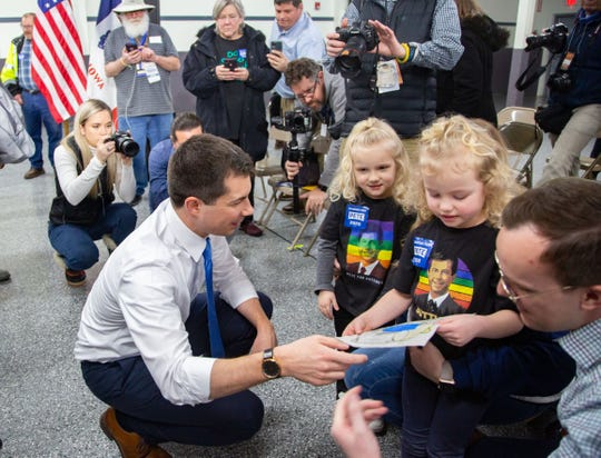 Lilly Eastwood, 5, and her sister Nora, 3, of Ft. Dodge give a drawing to Democratic presidential candidate former South Bend, Ind., Mayor Pete Buttigieg after a campaign event in Boone, Iowa Monday, Jan. 27, 2020.