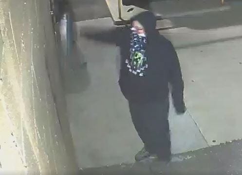 Screenshot taken from surveillance video of man who police say sprayed racist graffiti on a building in Madison Heights.
