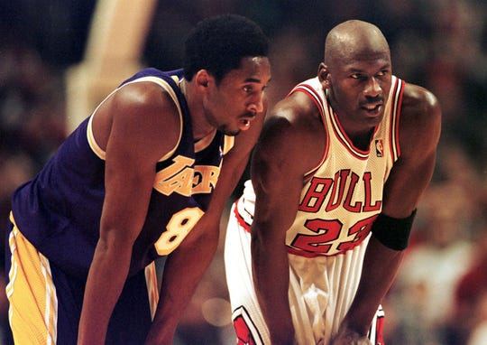 Lakers guard Kobe Bryant, left, and Bulls guard Michael Jordan talk during a free-throw attempt during the fourth quarter Dec. 17, 1997 at the United Center in Chicago.