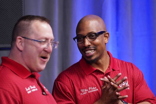 Mike Plater (right), Plant Chairman of UAW Local 22, chats after an announcement of GM's $2.2 billion investment in Detroit-Hamtramck assembly plant on being 100 percent devoted to electric vehicles Monday, January 27th, 2020.