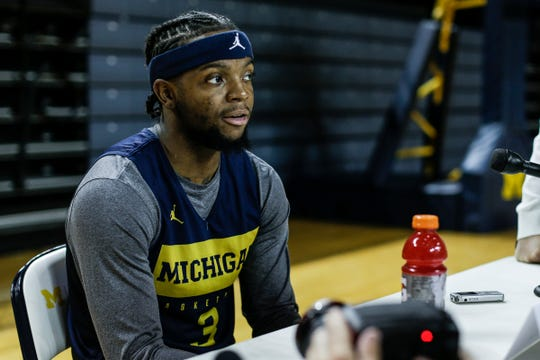 Michigan guard Zavier Simpson (3) answers a question during media day at Crisler Center in Ann Arbor, Thursday, Oct. 17, 2019.