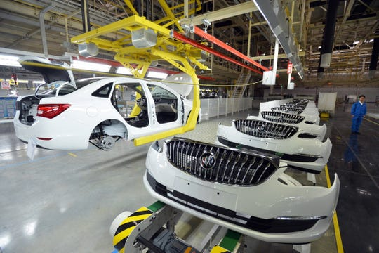 This photo from 2015 shows Buick cars being assembled at GM's Wuhan auto plant in Wuhan, central China's Hubei province.