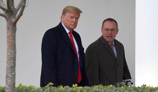 In this Jan. 13, 2020. file photo, President Donald Trump and acting White House chief of staff Mick Mulvaney walk along the colonnade of the White House in Washington.
