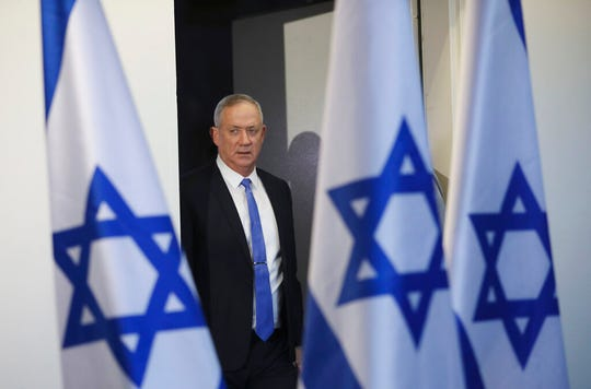 In this Nov. 20, 2019, file photo, Blue and White party leader Benny Gantz arrives to address media in Tel Aviv, Israel.  A blueprint the White House is rolling out to resolve the decades-long conflict between the Israelis and Palestinians is as much about politics as it is about peace. President Donald Trump said he would likely release his long-awaited Mideast peace plan a little before he meets Tuesday with Israeli Prime Minister Benjamin Netanyahu and his main political rival Benny Gantz.