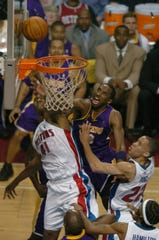 Kobe Bryant and Elden Campbell mix it up under the basket as the Pistons host the Lakers in Game 5 of the NBA Finals in 2004.