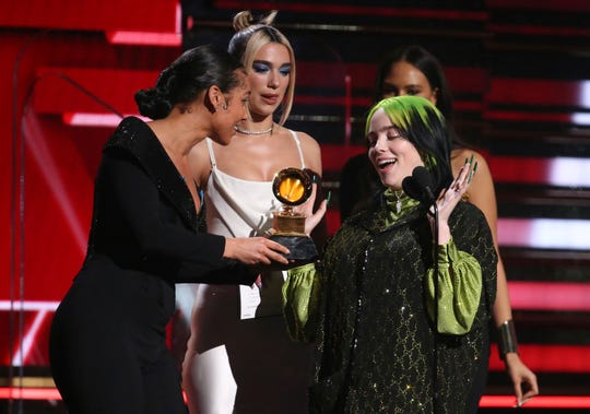 Alicia Keys, left, and Dua Lipa present Billie Eilish with the award for best new artist at the 62nd annual Grammy Awards on Sunday, Jan. 26, 2020, in Los Angeles.