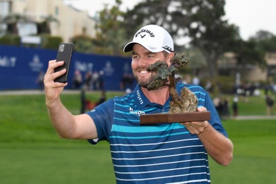 Marc Leishman takes a selfie with the winner's trophy after winning the Farmer's Insurance Open at the Torrey Pines on Sunday.
