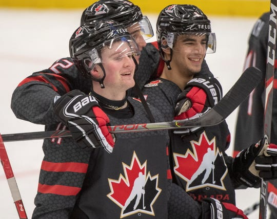 Alexis Lafreniere, left, and Red Wings prospect Joe Veleno, right, were linemates for Canada during the World Junior Hockey Championships in Ostrava, Czech Republic.