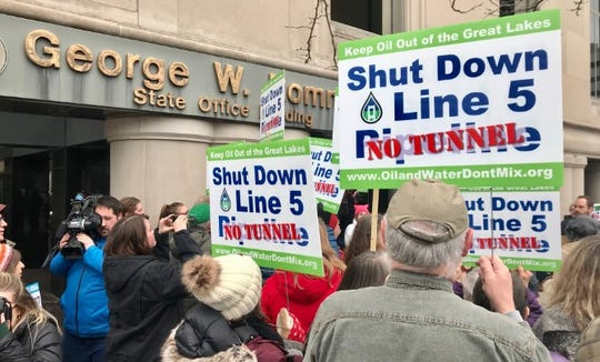 Demonstrators gather outside Gov. Gretchen Whitmer's office in downtown in Lansing on Monday, Jan. 27, 2020, to deliver 14,039 petition signatures asking the governor to shut down Line 5.