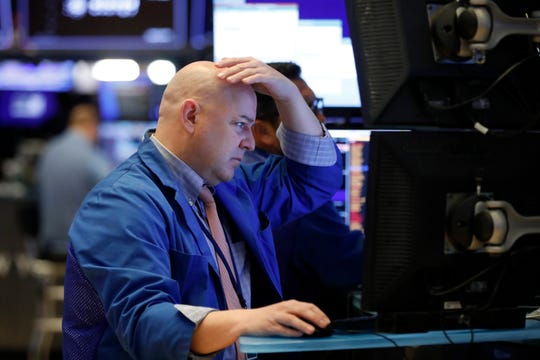 A trader works on the floor of the New York Stock Exchange last month as investors dumped shares on fears of the coronavirus.
