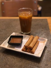 Lumpia with a side of sauce and Thai tea at Edamame in Madison Heights.