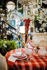 A red plaid tablecloth is a timeless addition that can go from romantic dinner for two to a summer picnic and back to a jolly Christmas. (Handout/TNS)