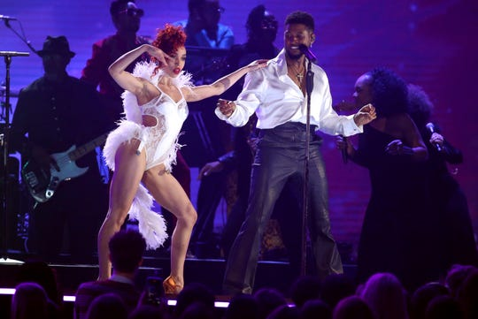 FKA twigs, left, and Usher perform during a Prince tribute.