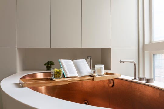 An oversized copper lined tub serves as the cornerstone in a luxury bathroom. (Design Recipes/TNS)