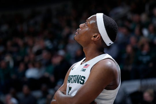 Cassius Winston looks at the Breslin Center scoreboard on Nov. 10, the day after his brother Zachary died.